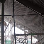 Debris netting under the bleachers in a sports stadium.