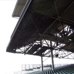 Debris mesh netting installed under seating in a sports stadium