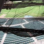 Debris netting provides safety for the public at a stadium.