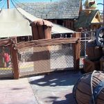 A barrier railing using mesh netting in a theme park.
