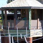 A barrier railing at a marina using mesh netting.