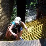 A child climbing a net ramp