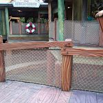 Netting incorporated into a barrier railing.