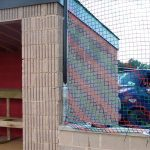 Barrier netting for a Little League Baseball field.