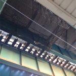 Safety netting attached with cabled under an elevated commuter rail station.
