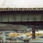 Safety netting suspended under a n elevated highway during construction.