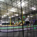 People playing dodge-ball in trampoline parks