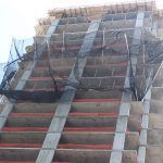 A perimeter safety netting system provided fall protection for workers and the public.
