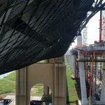 Bridge netting installed to catch falling debris while a bridge is dismantled.