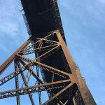 Safety netting installed beneath a railway bridge.