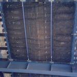 Bridge netting installed beneath a commuter rail bridge.