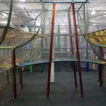 A rope bridge connecting two play areas in a structure.