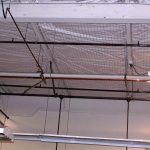 Netting used to control ceiling debris from falling on pedestrians.