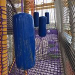 Obstacles used in a netted play structure