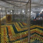 Colorful climbing nets connecting to a slide