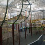 Children's climbing structures with netting platforms
