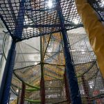 Levels of climbing nets leading to the top of a play structure.