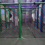 The entrance to a maze constructed out of mesh netting.