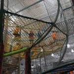 a netted platforms with several children playing on it.