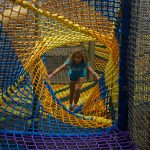 A colorful net made into a mtunnel.