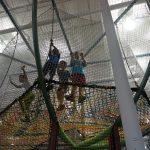 Children playing on climbing nets.