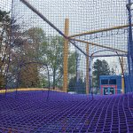 A rope bridge with barrier mesh netting.
