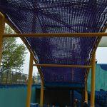 A purple rope bridge.