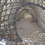 A climbing net in play structure.