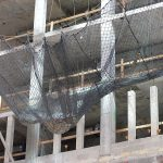 Safety netting catches falling debris.