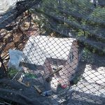 Safety netting can prevent debris from falling on adjacent properties.
