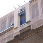 Facade-containment-netting-being-installed on FBE building
