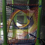 A multi-colored tunnel made of netting