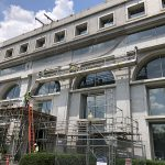 A facade safety netting system being installed on an historic building during reconstruction.