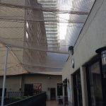 Netting protects a commercial arcade from falling debris.