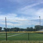 Crowd safety netting at a high school athletic field.