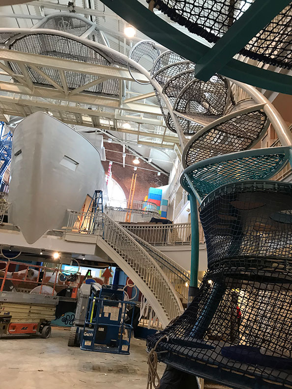 The Sky Climber arches above the boat at Port Discovery Children's Museum.