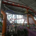 Safety netting mounted under a roller coaster.