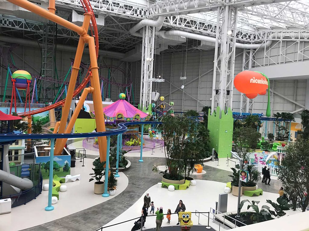 An indoor amusement park featuring roller coasters