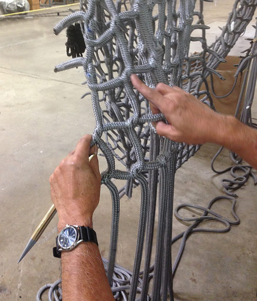 Making climb netting by hand.