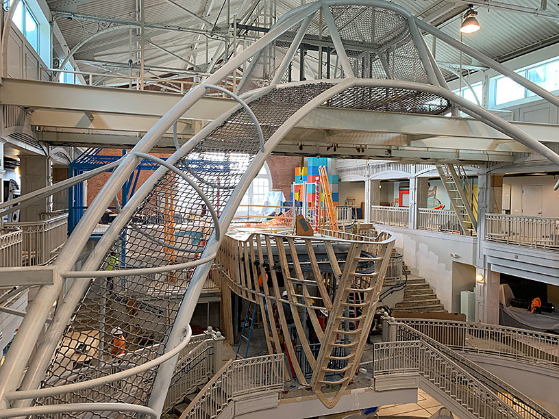 A ship being constructed in a children's museum.