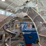 A boat and netted towers in a children's museum.