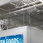 Barrier safety netting for the top of a freezer unit.