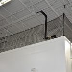 Barrier netting for an elevated storage or work area.