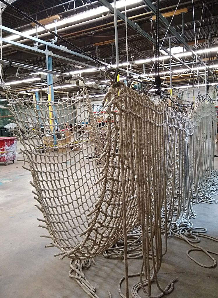 The intermediate manufacturing stage of a climbing net.