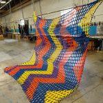 A multicolored climbing net.