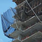 Safety netting outrigger arms on a construction project.