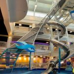 A climbing structure with a slide in a children's museum.