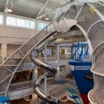 A netted climbing structure in a children's museum.
