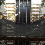 Netting in a hotel lobby provides protection from falling debris