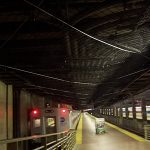 Netting affixed the ceiling of a busy commuter train station, protects pedestrians from falling debris.